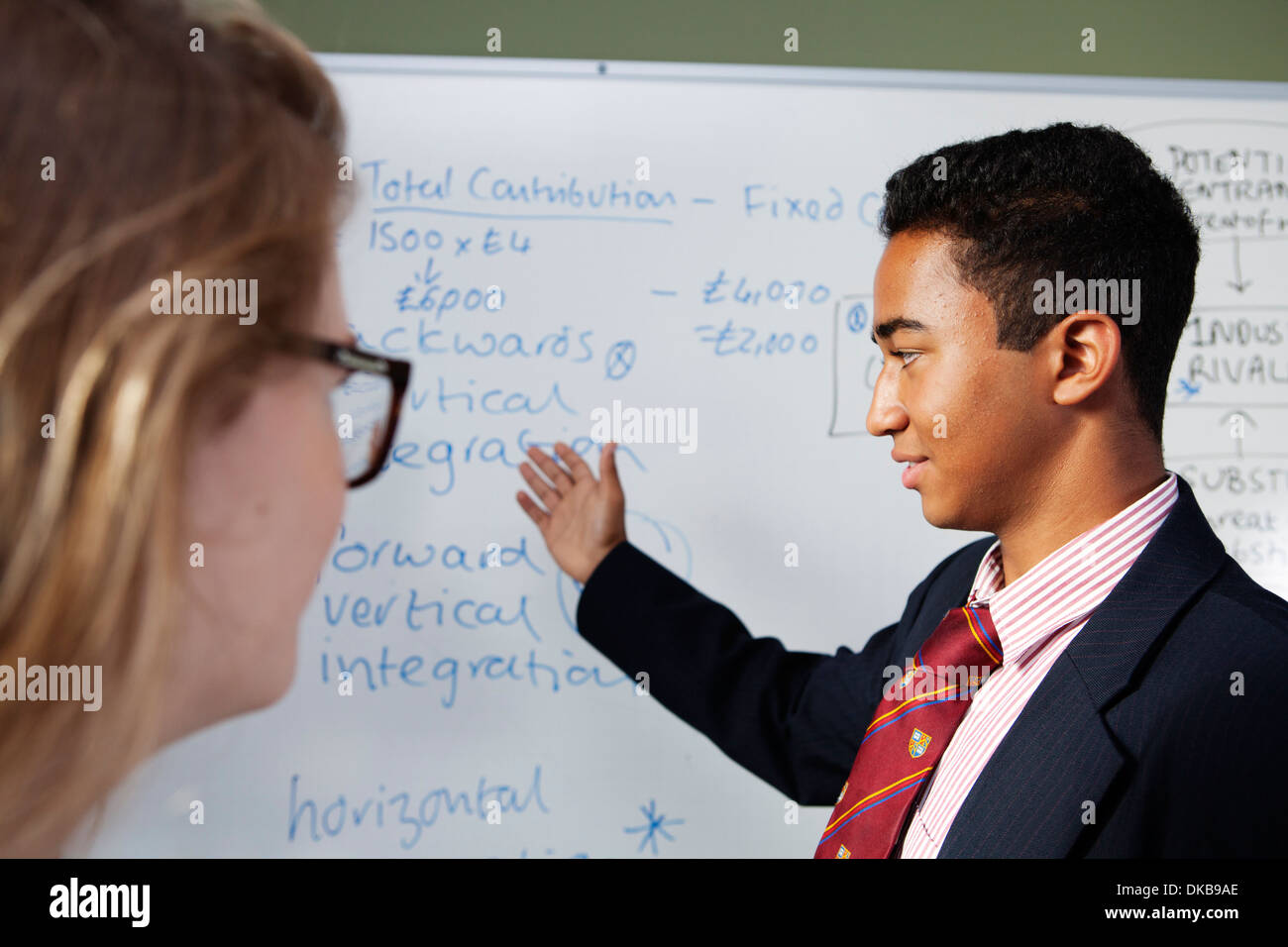 Schoolboy presenting ideas in class - Stock Image