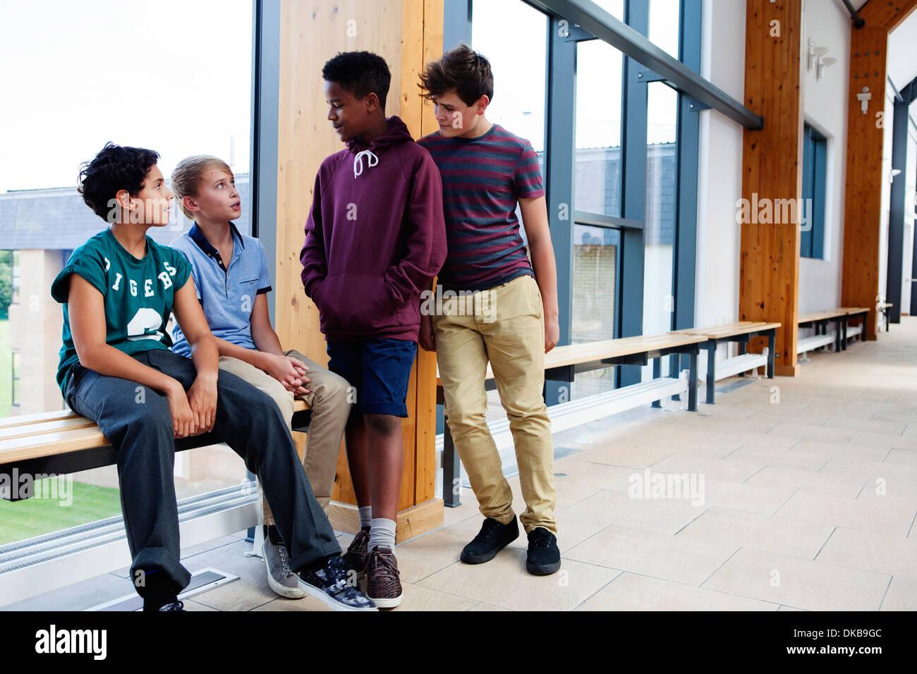 Group of teenage schoolboys in corridor - Stock Image