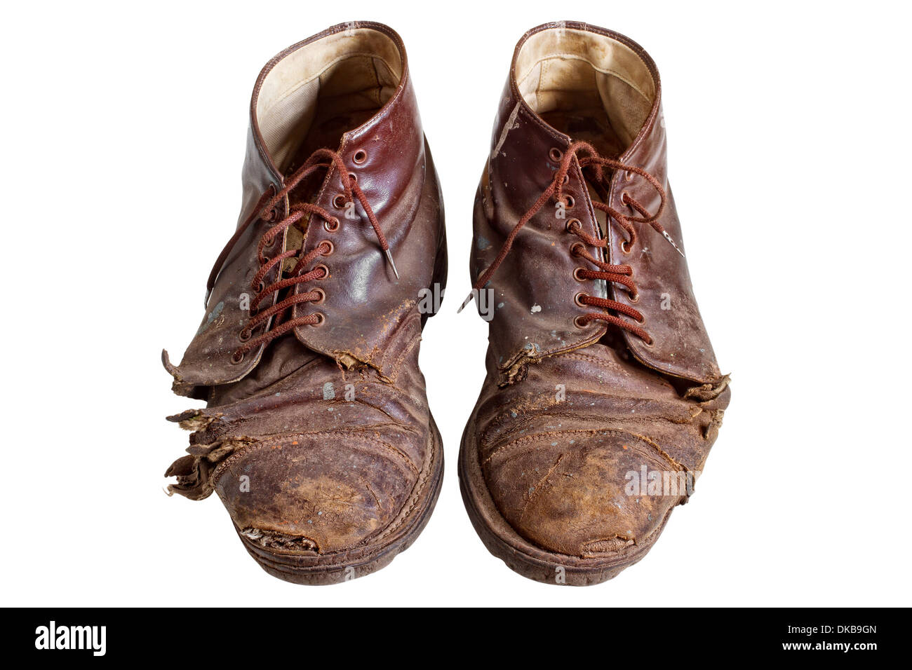 Old worn out boots, isolated on white - Stock Image