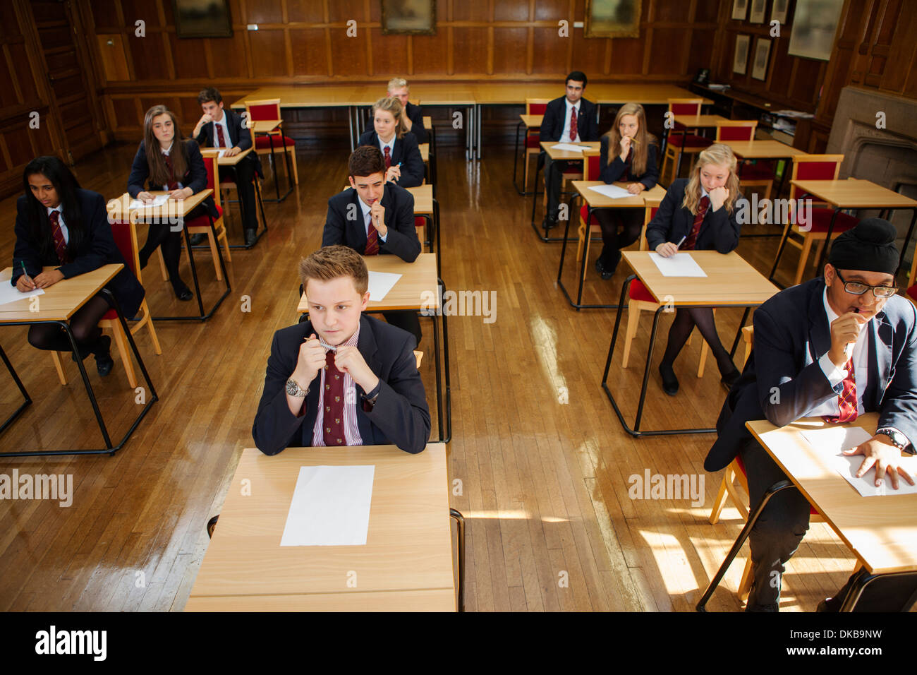 Group of  teenage schoolchildren in exams - Stock Image