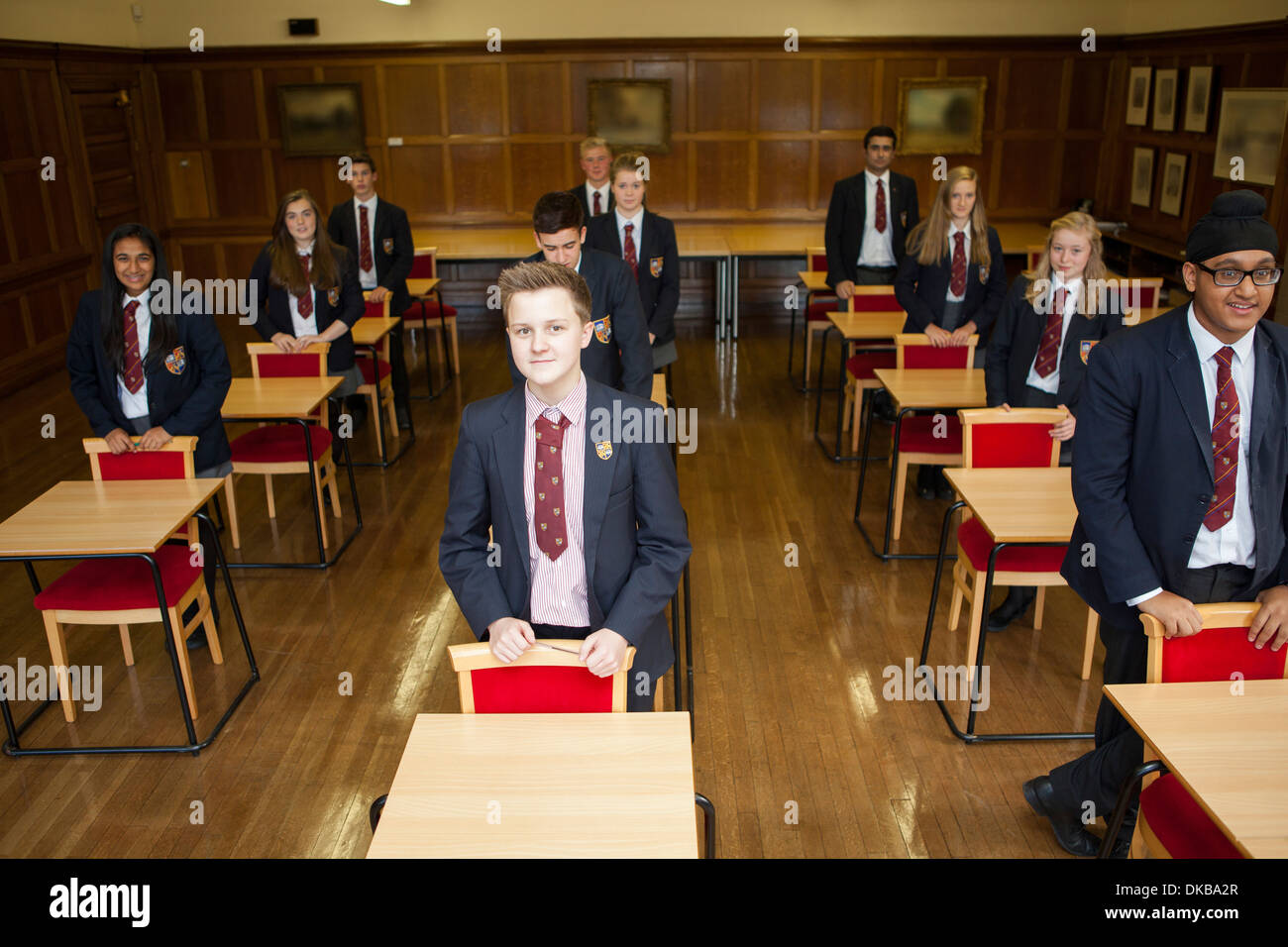 Teenage schoolchildren standing in exam class - Stock Image