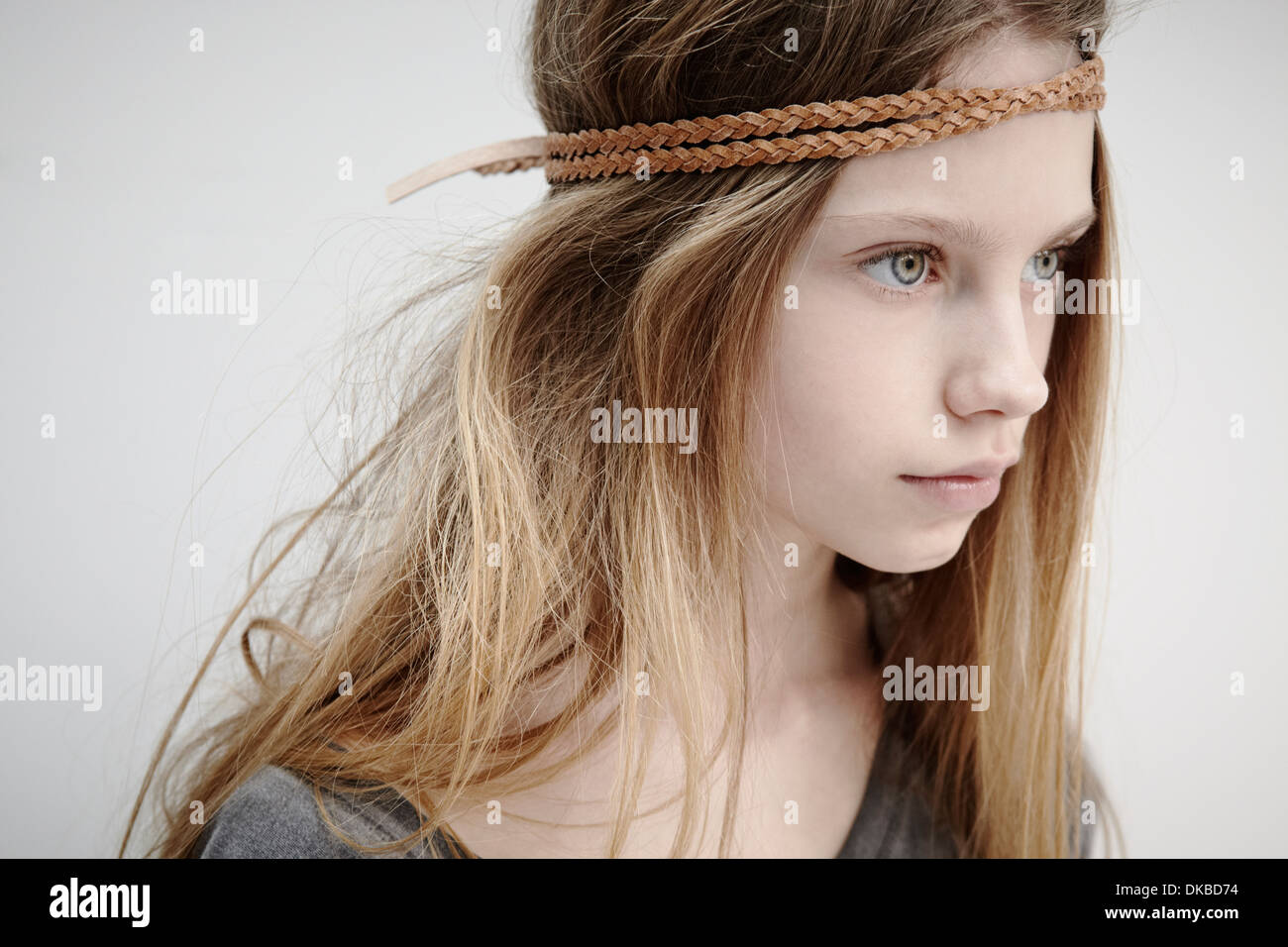 Portrait of girl wearing leather braid around head - Stock Image