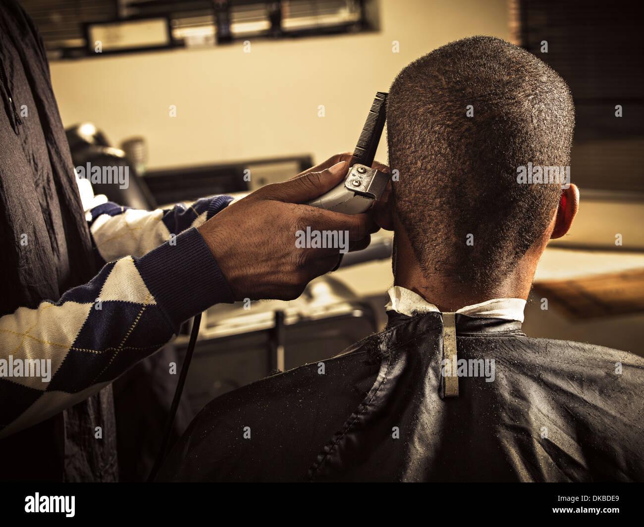 Man having haircut at barber shop - Stock Image