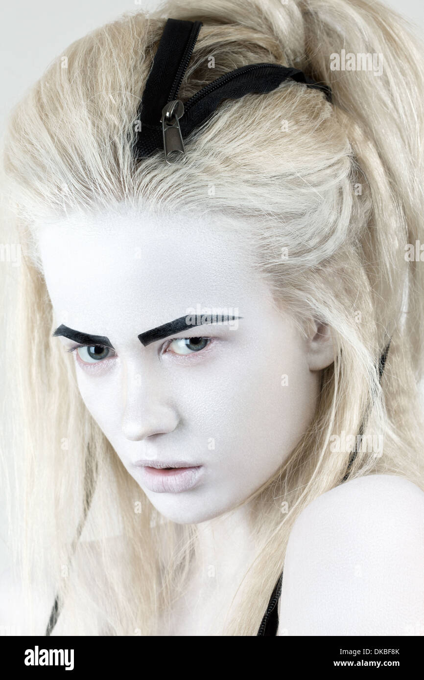 Portrait of mysterious albino woman with black eyebrows - Stock Image