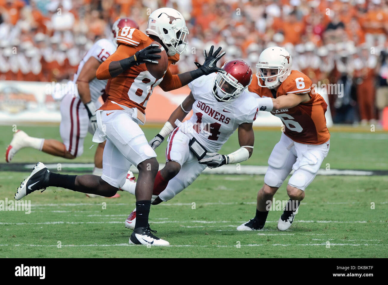Oct. 8, 2011 - Dallas, Texas, U.S - Texas Longhorns wide receiver Miles Onyegbule (81) looks to stiff arm Oklahoma Sooners defensive back Aaron Colvin (14) during first half action of the Red River Rivalry between the #3 Oklahoma Sooners and #11 Texas Longhorns at Cotton Bowl in Dallas, Texas.  The Sooners lead 34-10 over the Longhorns at the half. (Credit Image: © Steven Leija/Sou - Stock Image