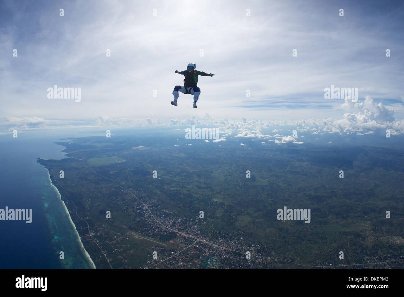 Solo Skydiver freeflying over Diani Beach, Kenya - Stock Image