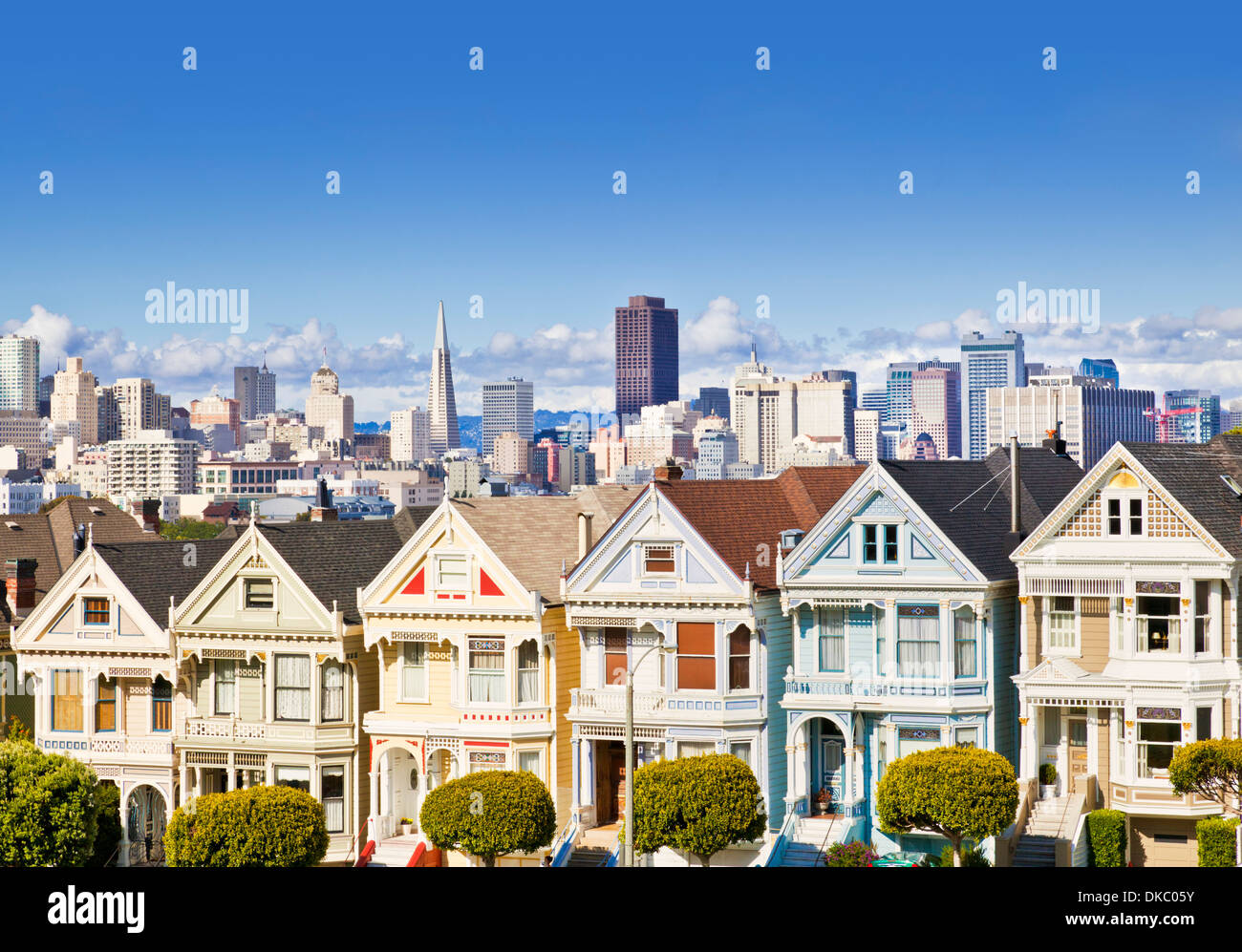 San Francisco Painted Ladies famous well maintained old Victorian houses on Alamo Square San Francisco California - Stock Image