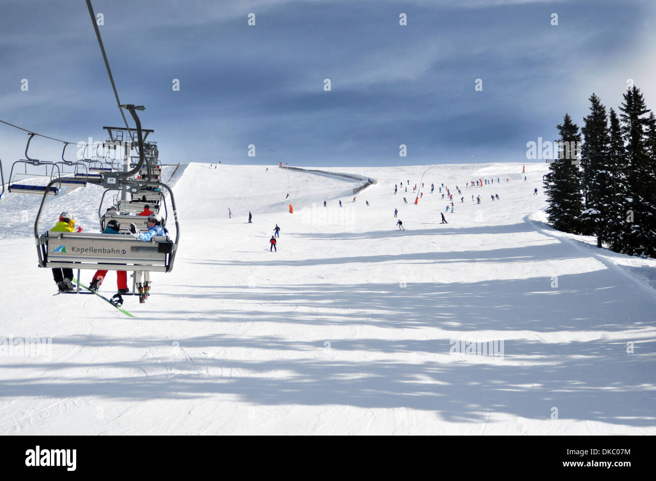 Ski Chair lift, with wide blue piste, Zell am See, Austrian Alps - Stock Image
