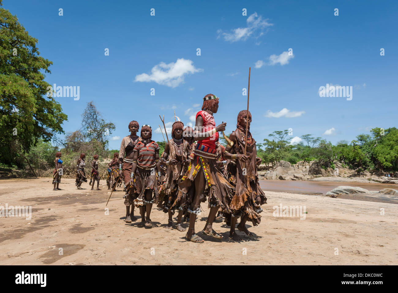 Women dancing during a bull jumping ceremony. A rite of passage from boys to men. Hamer tribe, Omo valley, Ethiopia - Stock Image