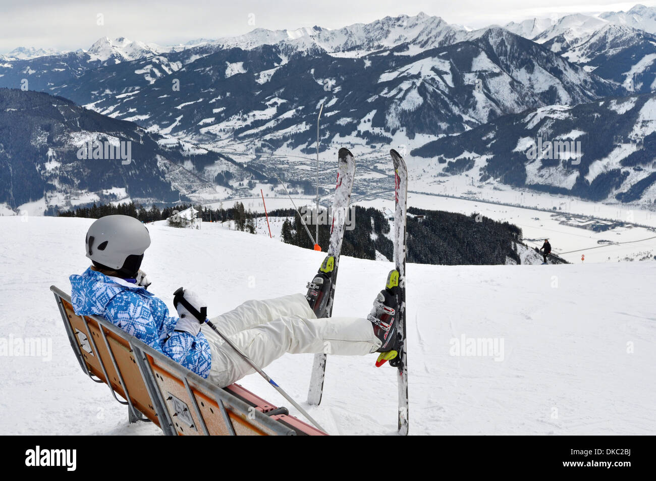 Sitting on a chair looking out to the piste,on a ski holiday,  Zell am See, Austria - Stock Image