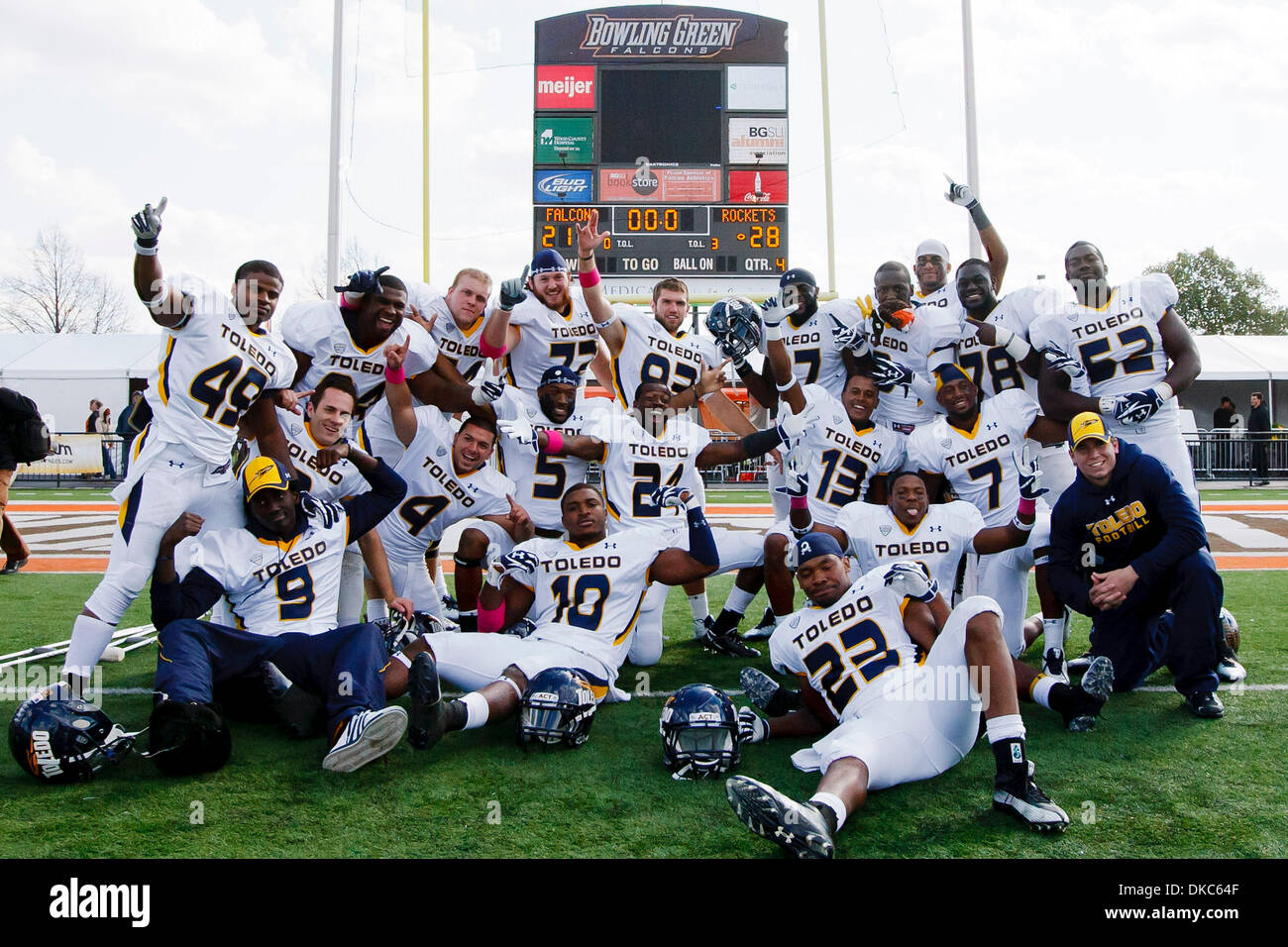 Oct. 15, 2011 - Bowling Green, Ohio, U.S - Toledo players pose for a photograph in front of the scoreboard at the conclusion of the game.  The Toledo Rockets, of the Mid-American Conference West Division, defeated the Bowling Green Falcons, of the MAC East Division, 28-21 in the inaugural game for the ''Battle of I-75'' trophy at Doyt Perry Stadium in Bowling Green, Ohio. (Credit I - Stock Image