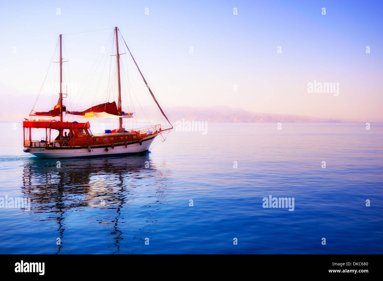 photo beautiful yacht departing into the unknown Stock Photo