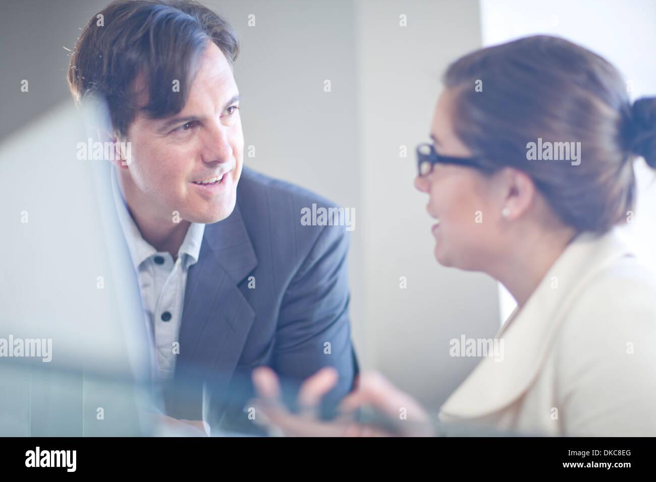 Businesspeople having conversation - Stock Image