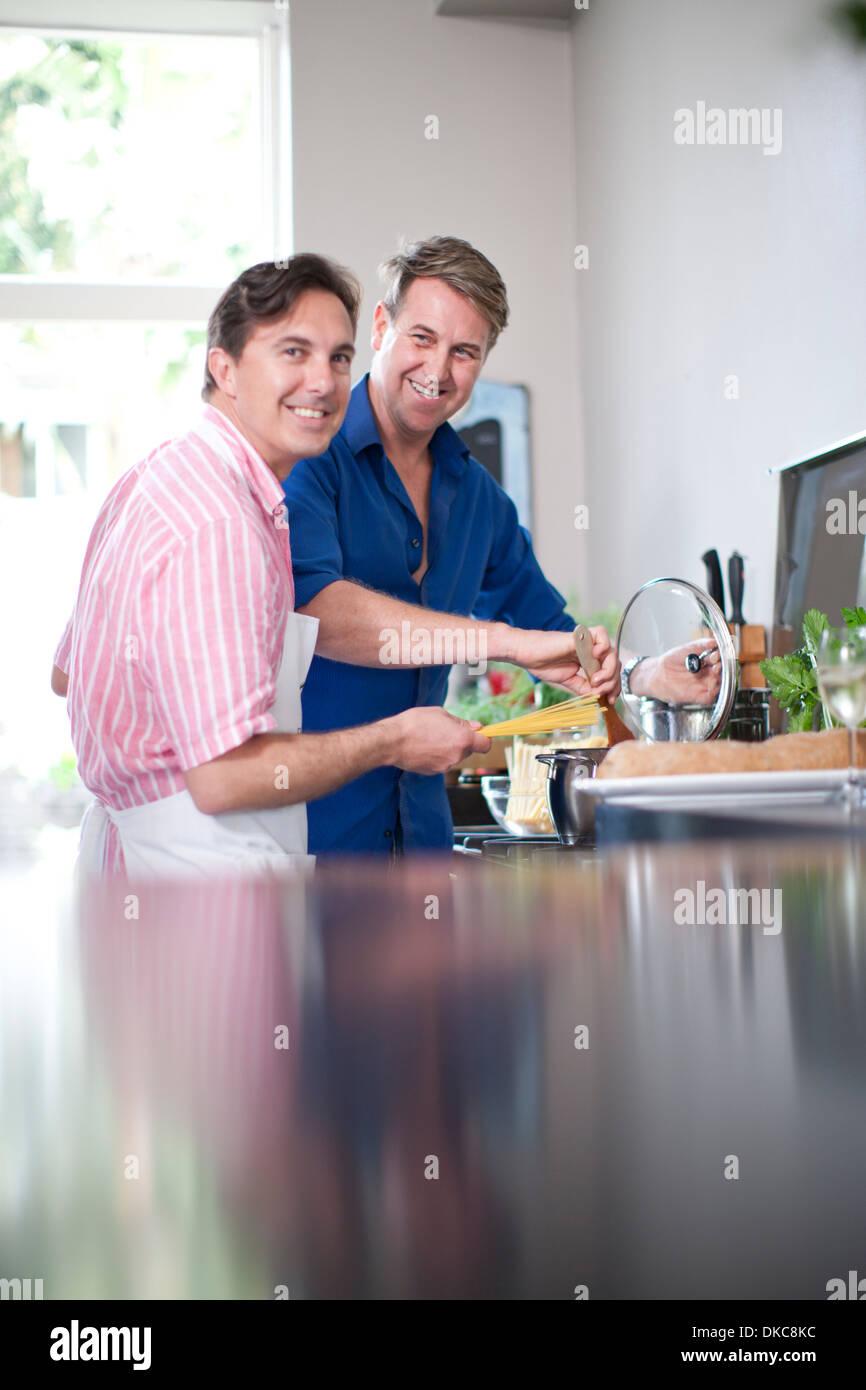 Mature men cooking - Stock Image