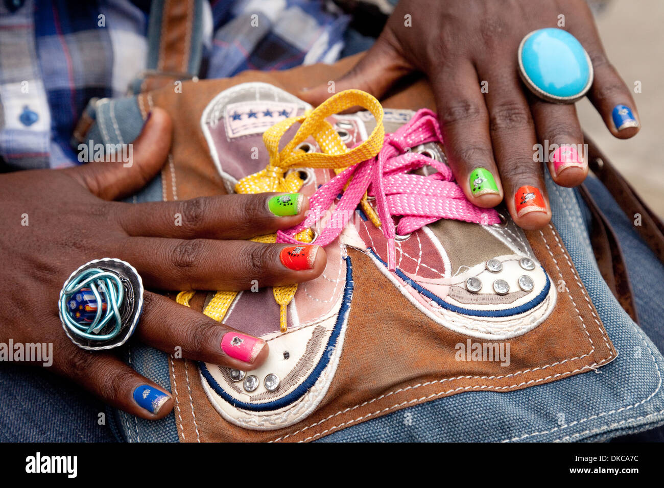 Cuban woman showing off her colourful painted nails and rings, Havana Cuba, Caribbean - Stock Image