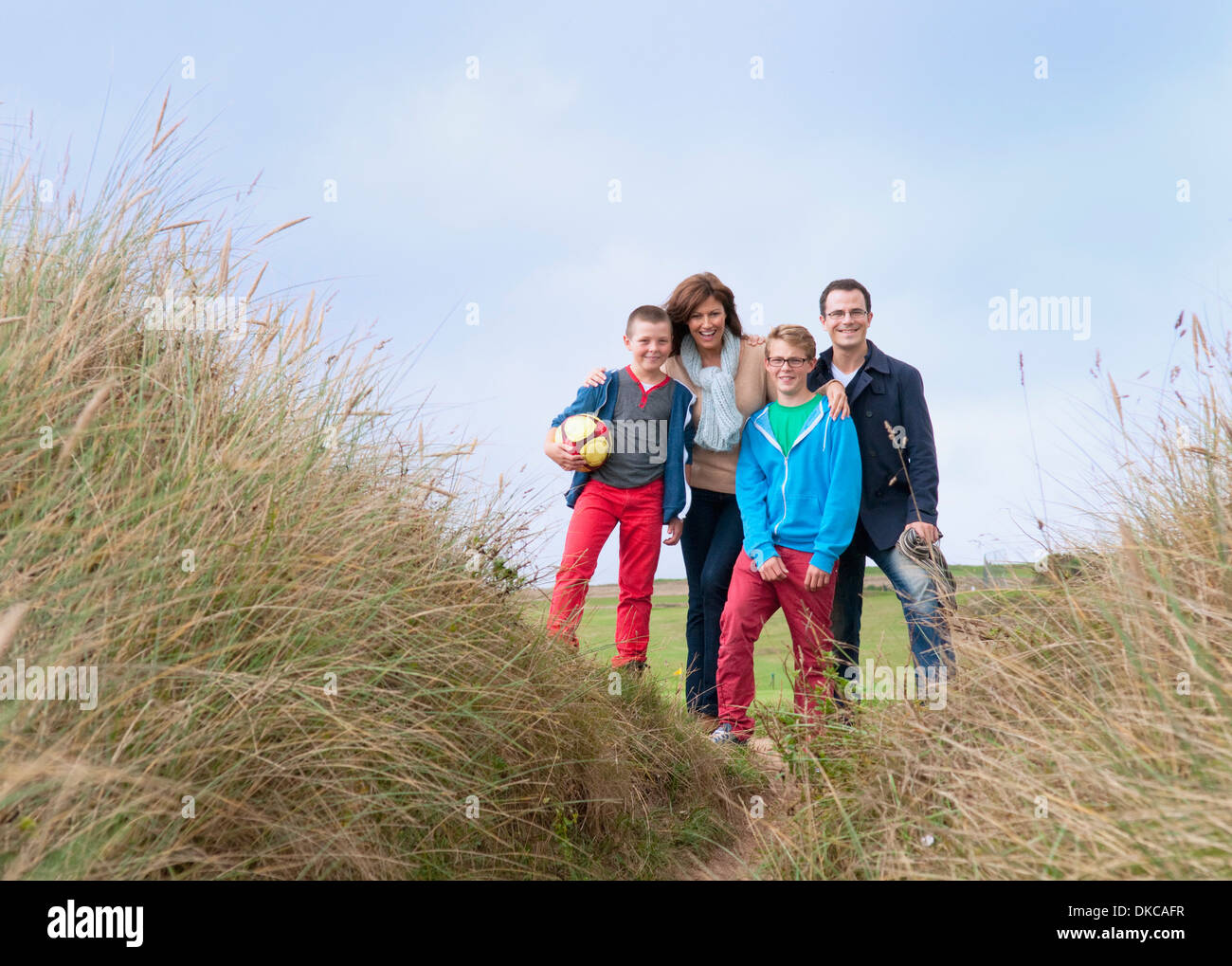 Family portrait on sand dunes - Stock Image