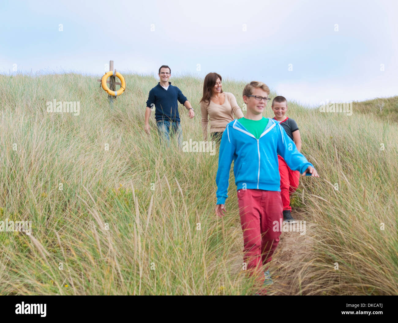 Family strolling coastal path Stock Photo