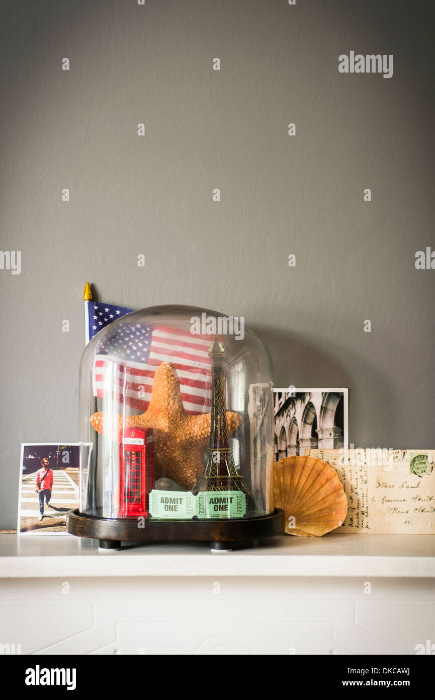 Collection of objects from vacations and travel with glass dome - Stock Image