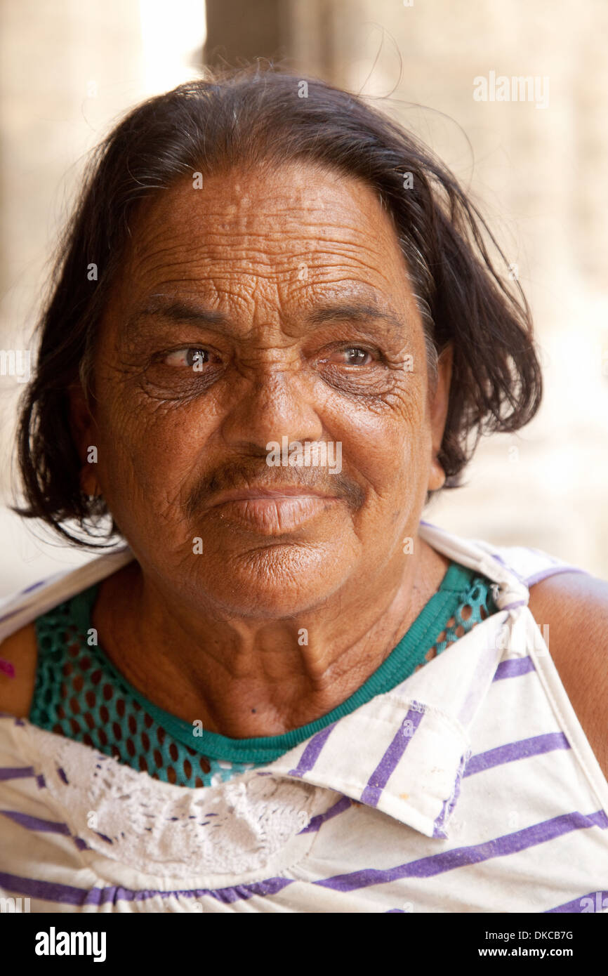 An elderly Cuban woman age aged 60s, head and shoulders portrait, Havana, Cuba caribbean - Stock Image