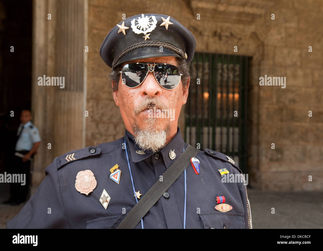 Cuban official guard smoking a cigar, Plaza de Armas square, Havana, Cuba Caribbean - Stock Image