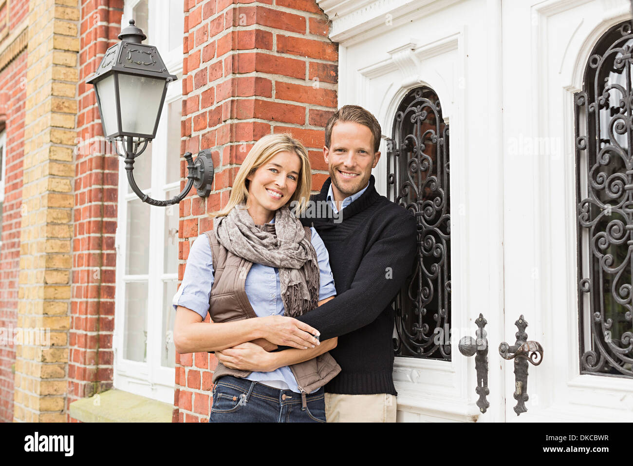 Mid adult couple outside house - Stock Image