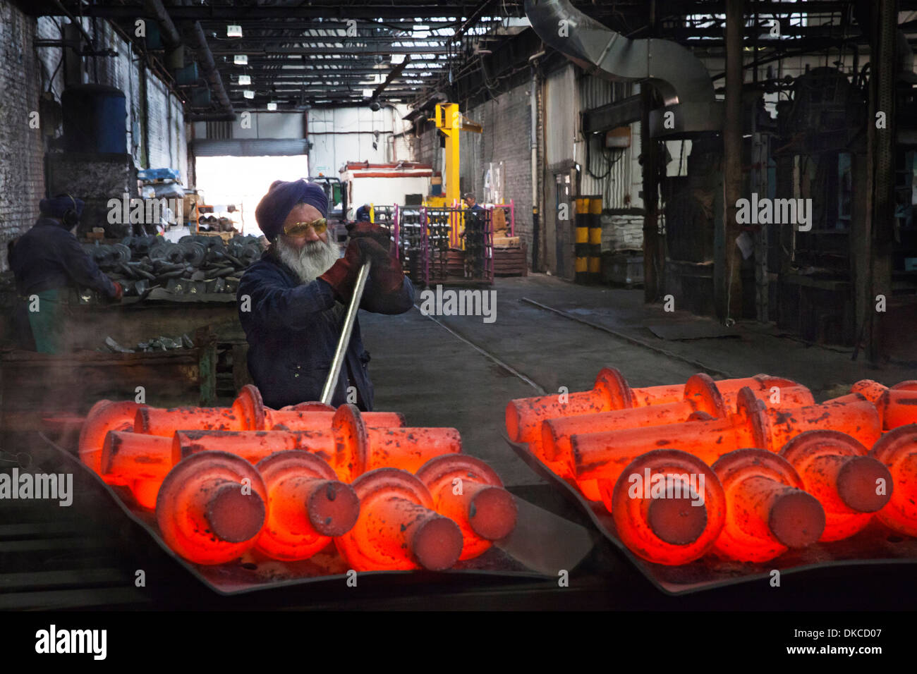 Operative levers still steaming drive shafts off trays in order to cool down - Stock Image
