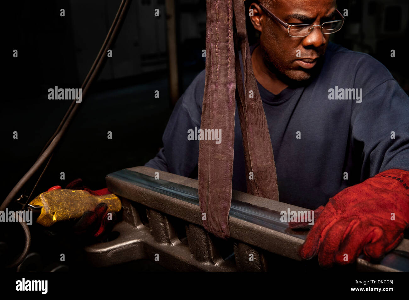 Lifting up a rack bar to be machined - Stock Image