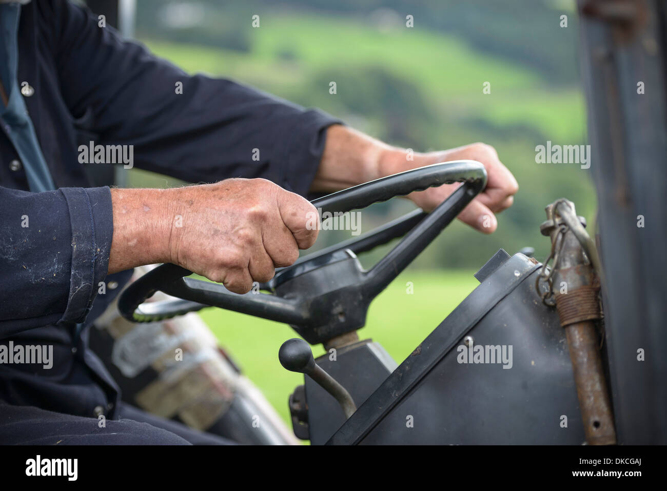 Mature farmer in tractor cab, close up Stock Photo