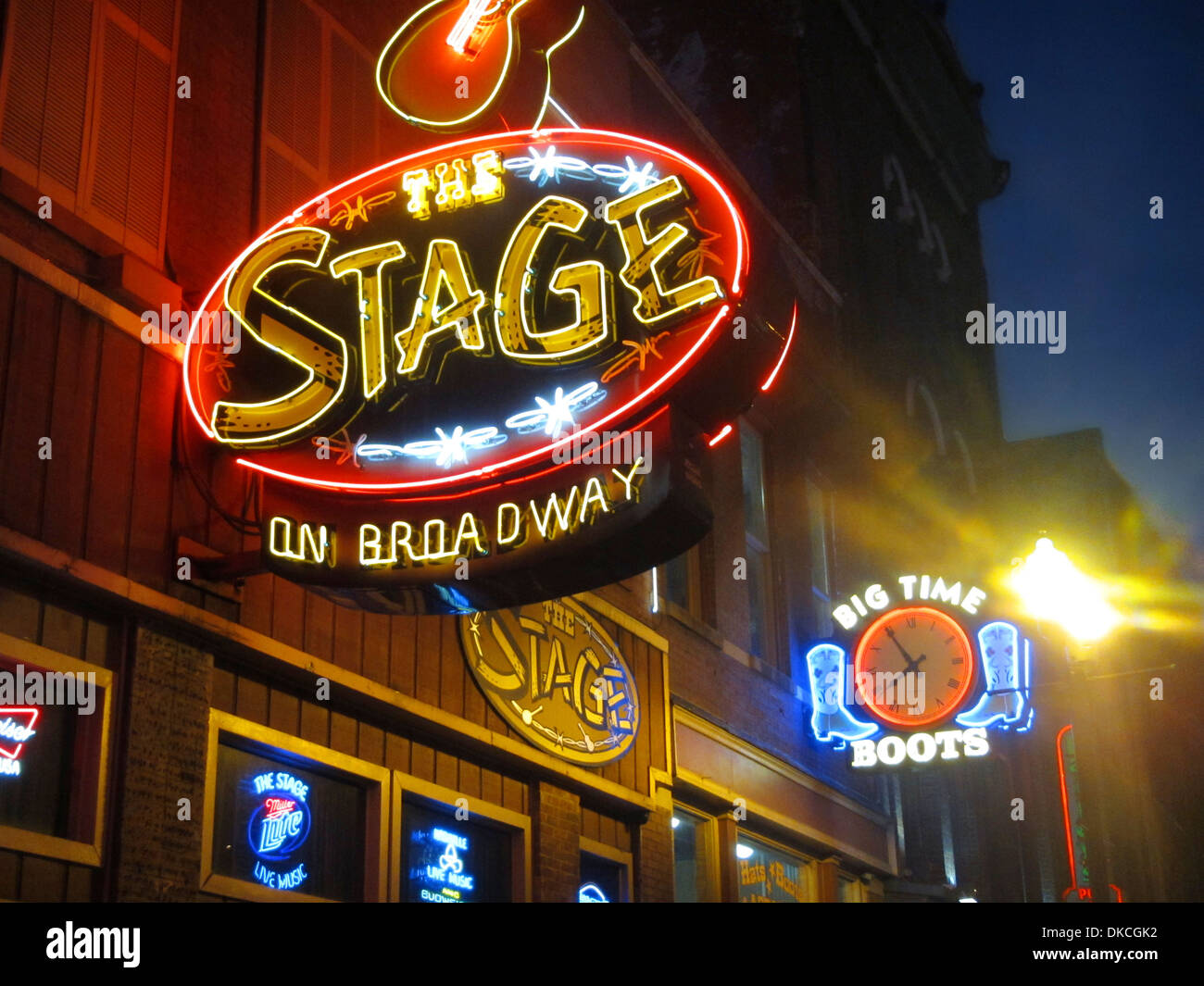 Neon signs outside Honky Tonk bars on Broadway in downtown Nashville Tennessee. - Stock Image