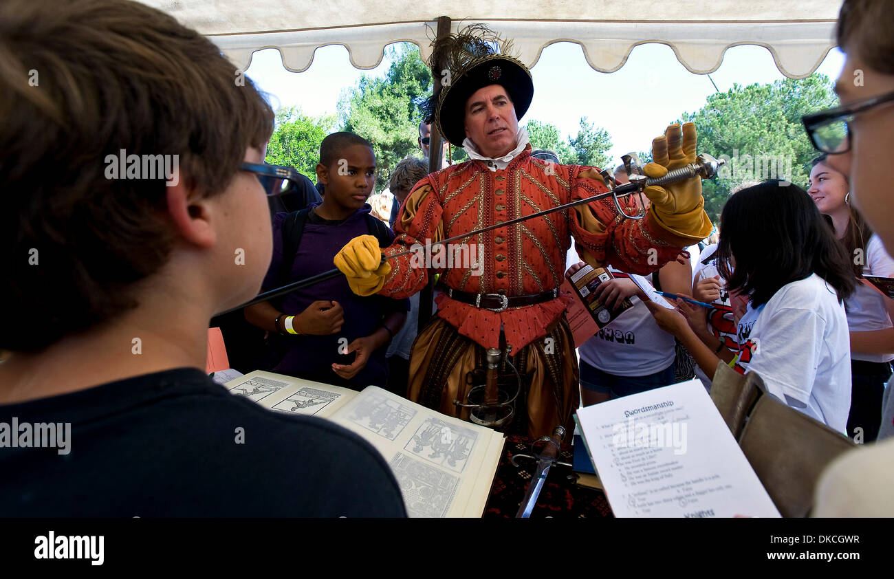 Oct. 21, 2011 - Poway, California, USA -  Thomas Fernandez teaches school children about 16th Century weaponry at Stock Photo