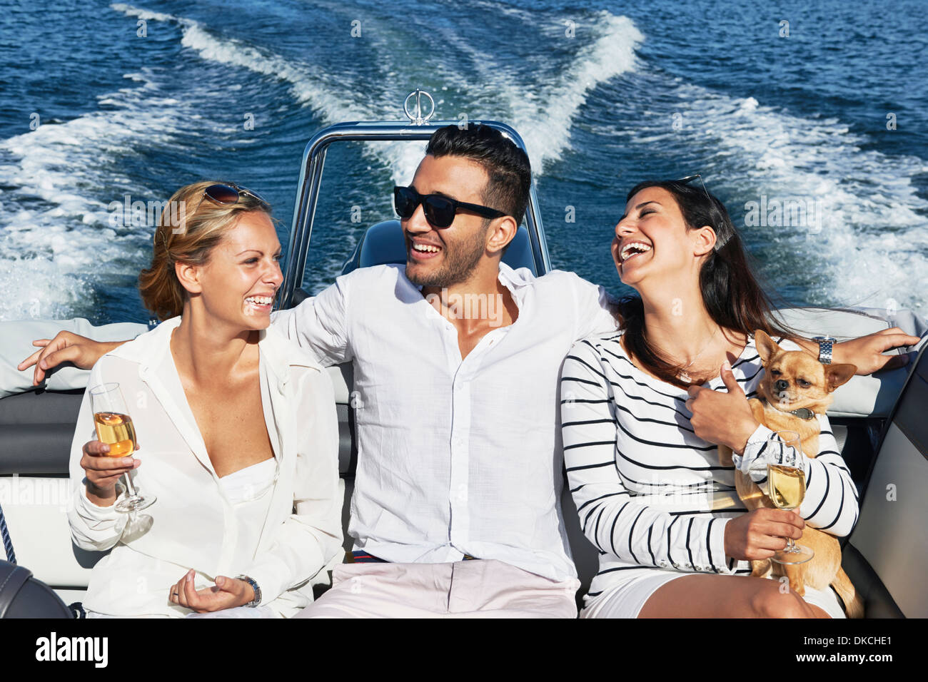 Young man on boat with arms around women, Gavle, Sweden - Stock Image
