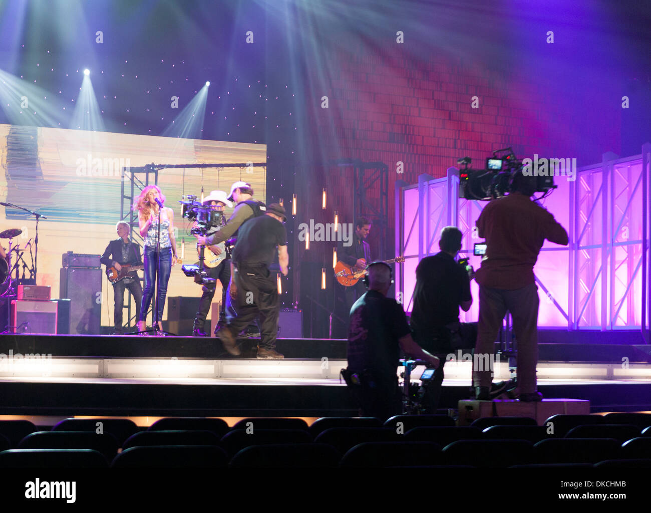 Film crews shoot footage during a musical performance on the set of the US TV show called Nashville and filmed in Nashville, TN - Stock Image