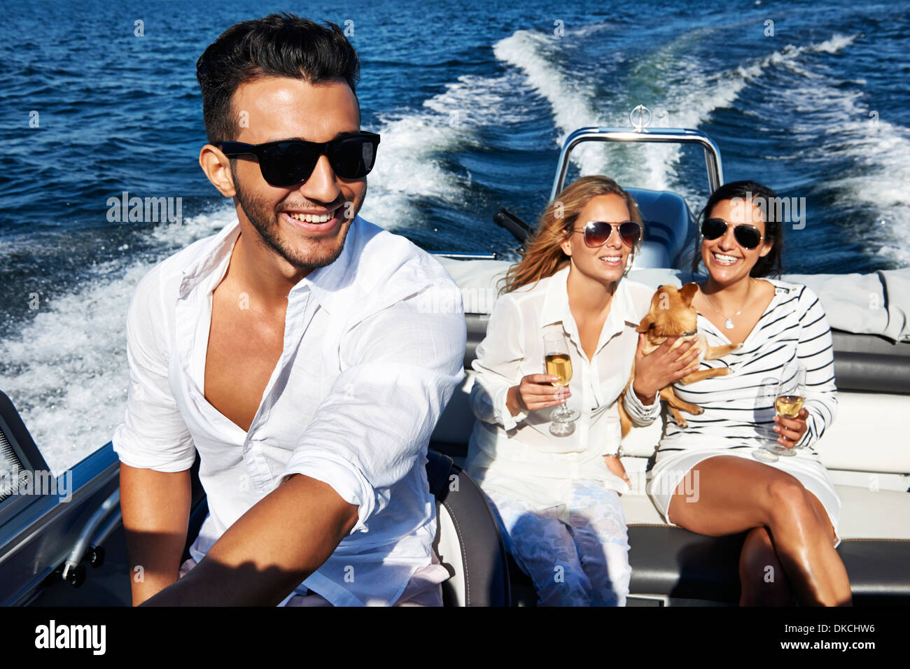 Young adults on boat, Gavle, Sweden - Stock Image