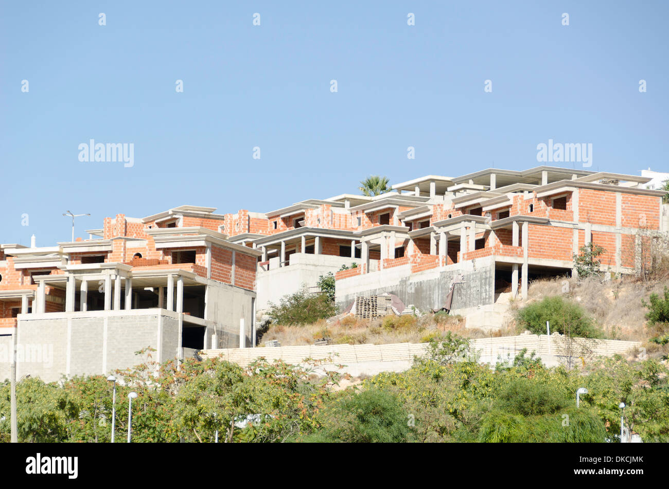 Unfinished buildings in Albufeira Portugal built with brick stones - Stock Image