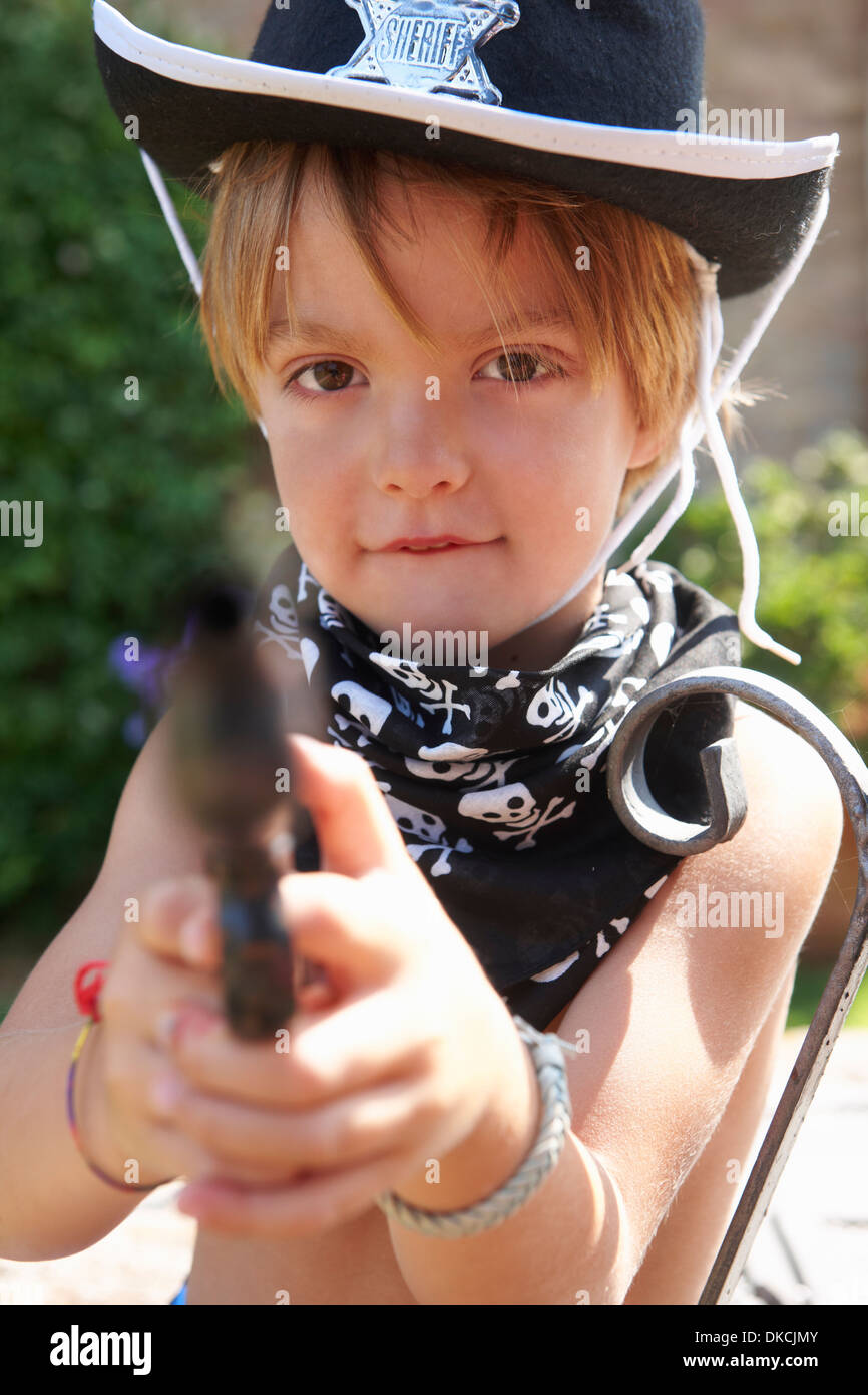 Boy in sheriff hat with gun - Stock Image