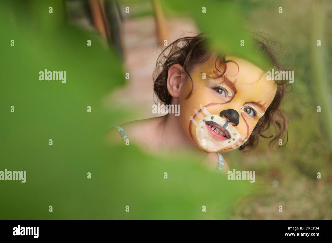 Girl with face painting of animal - Stock Image