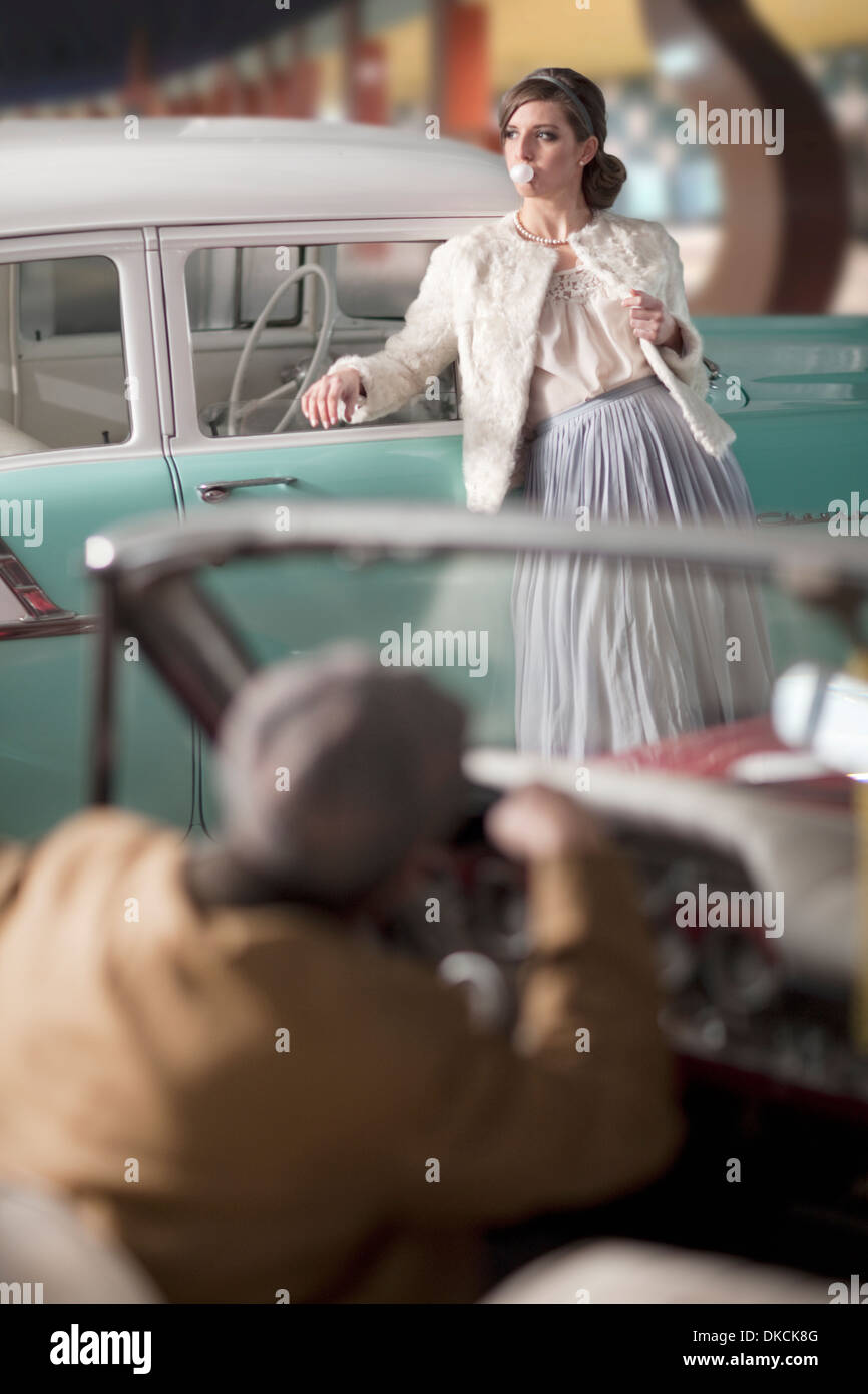 Nice Man Looking At Woman Leaning On Vintage Car   Stock Image