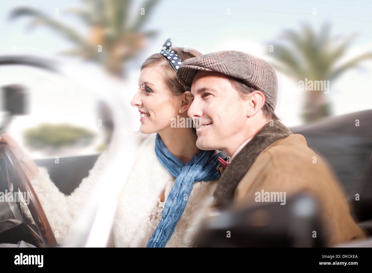 Side view of couple in convertible Stock Photo