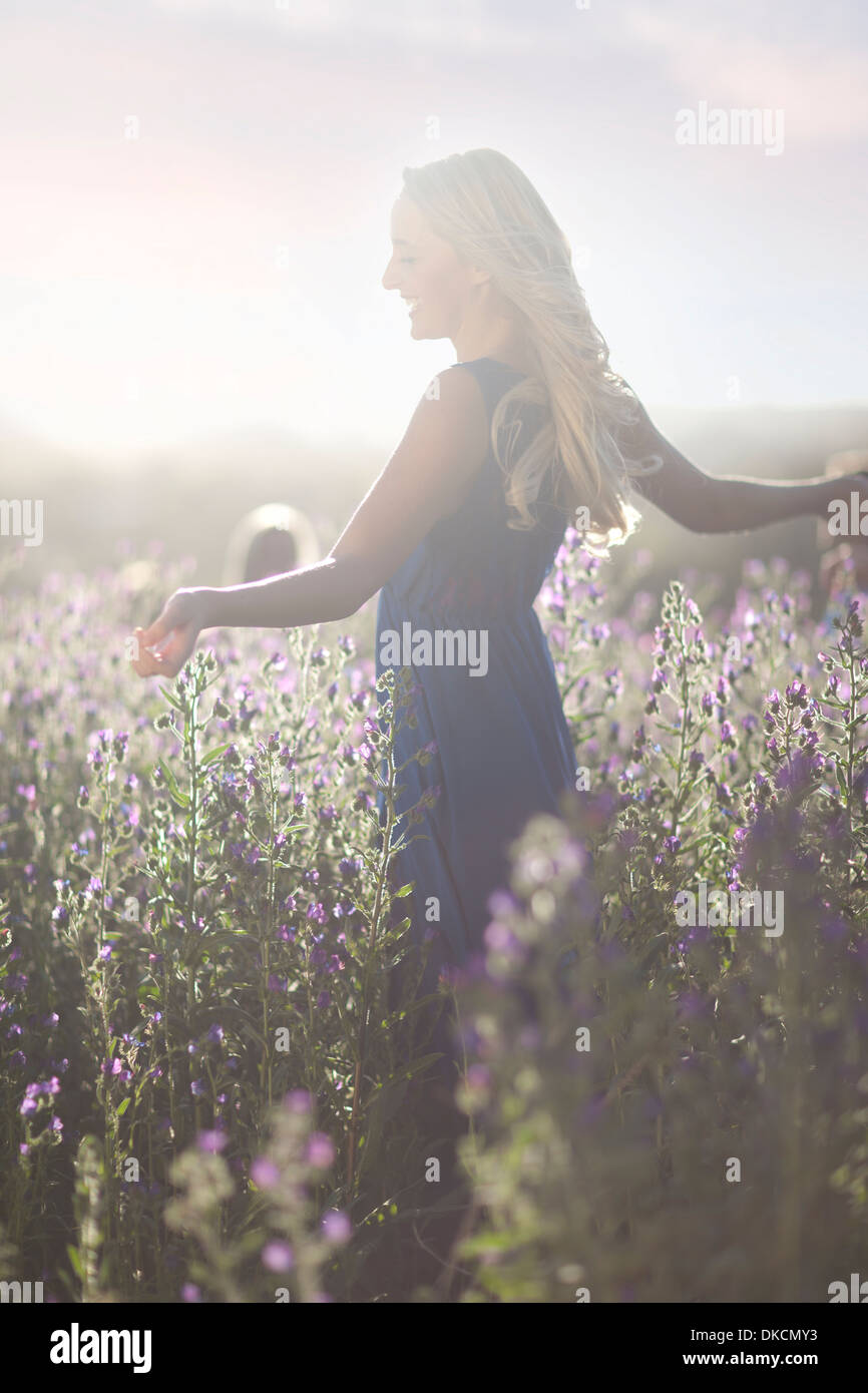Girl dancing on meadow - Stock Image