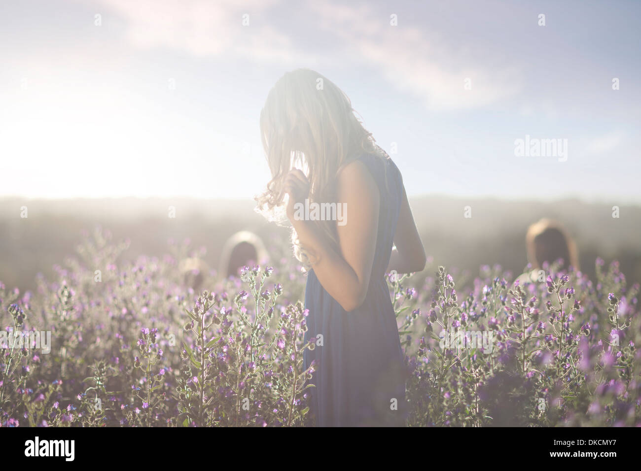 Girl standing on meadow - Stock Image