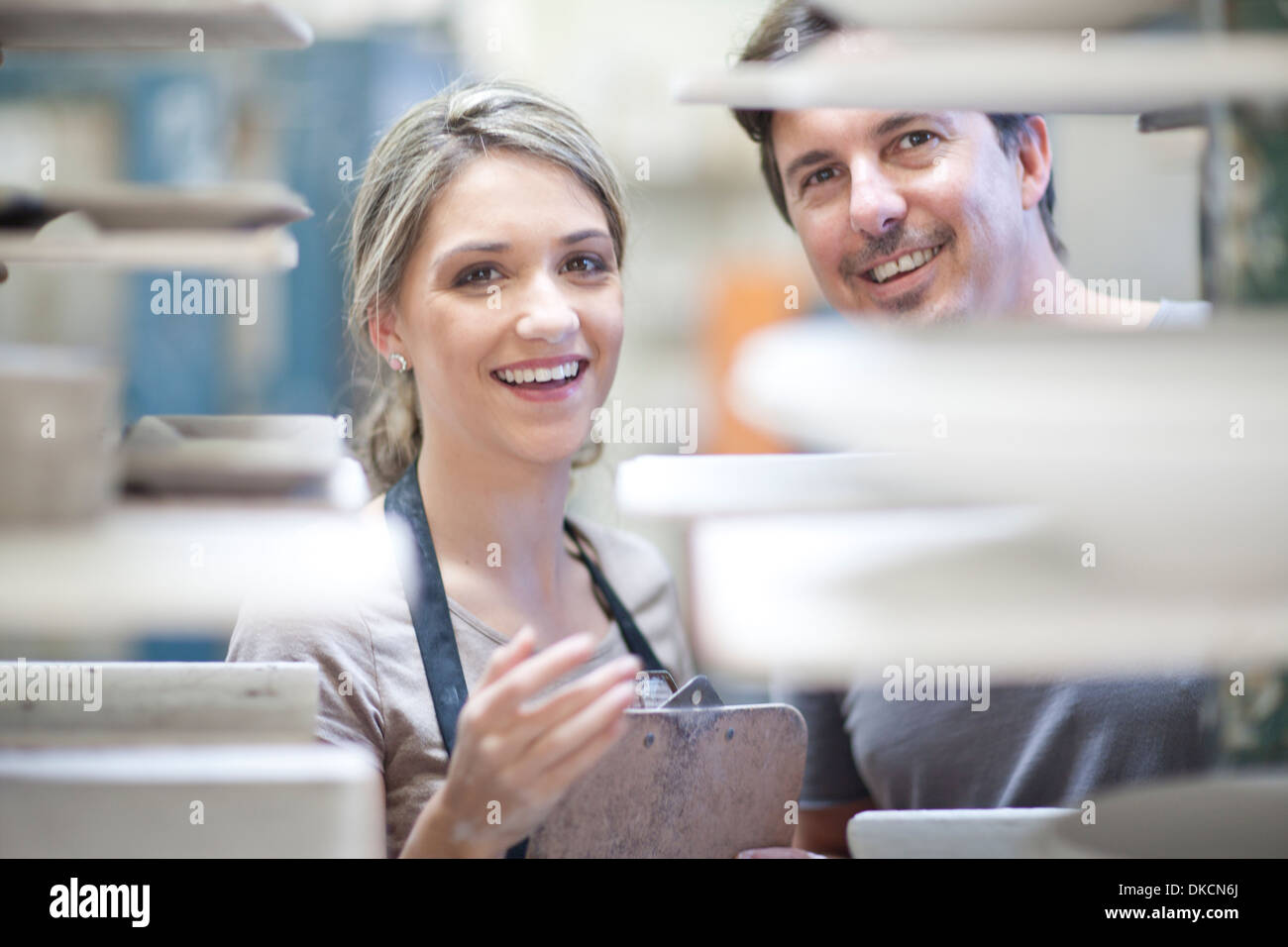 Potters at crockery factory - Stock Image
