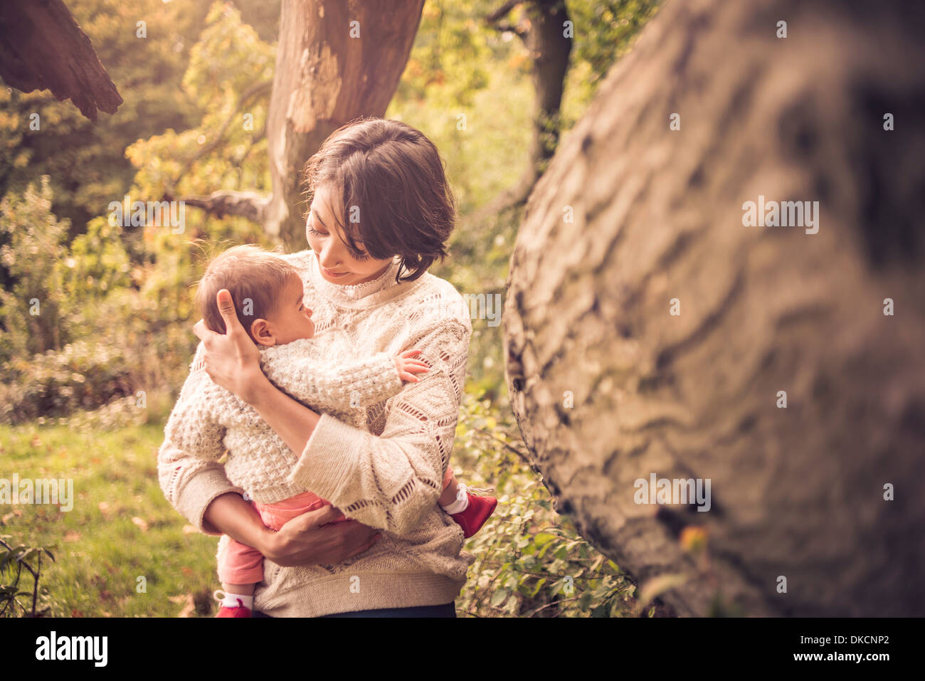 Mother and baby enjoying park Stock Photo