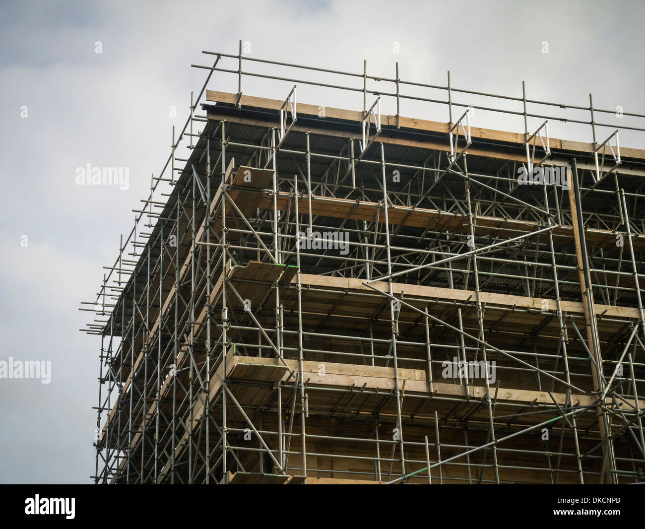 Building covered in scaffolding UK - Stock Image
