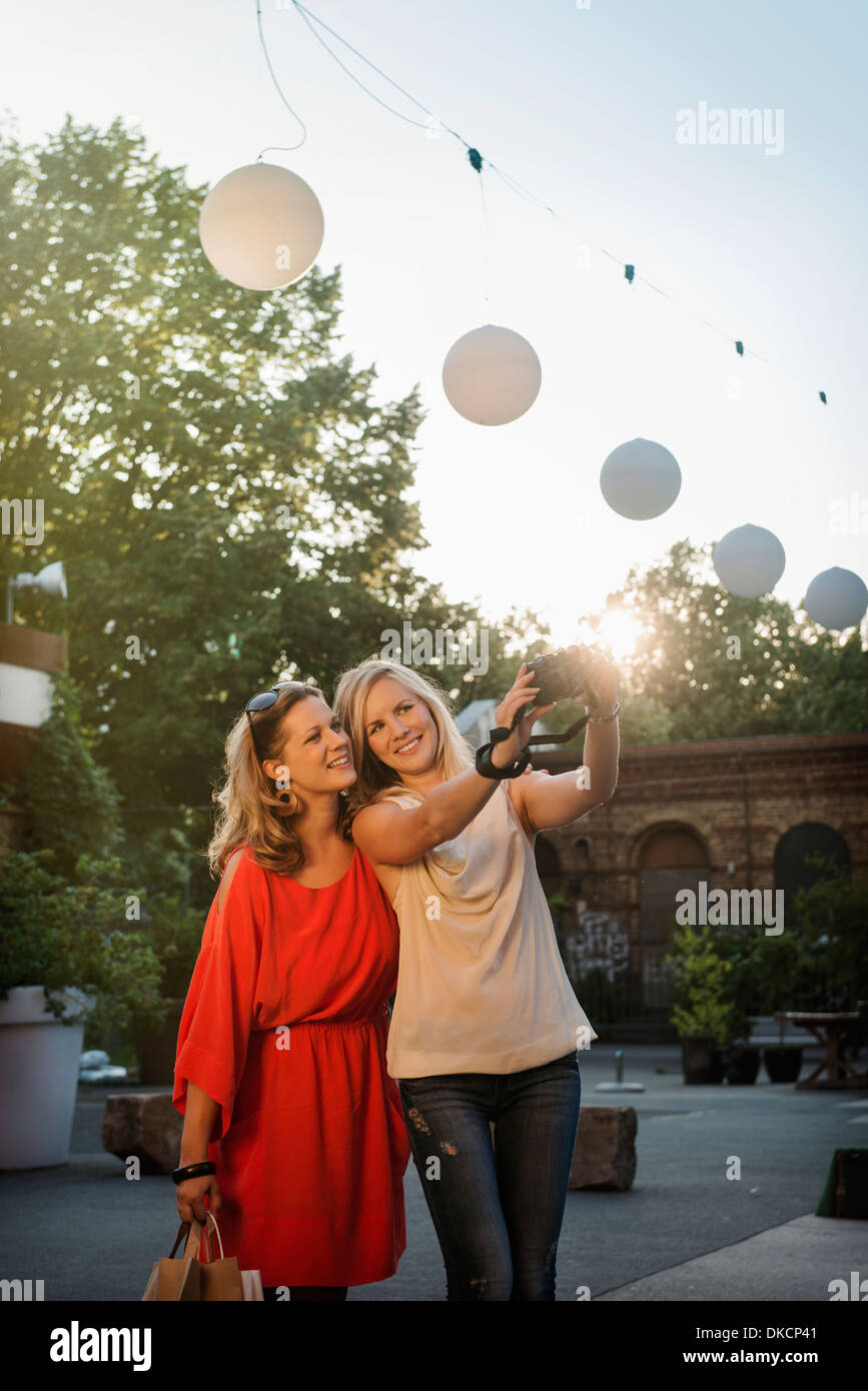 Two women taking self portrait, Berlin, Germany - Stock Image