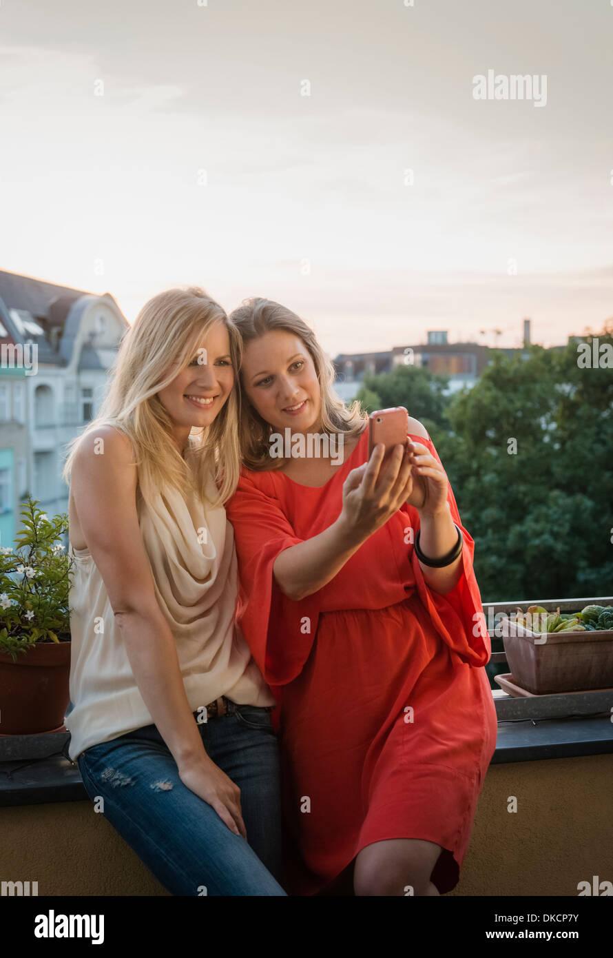 Two women making self portrait, Berlin, Germany - Stock Image