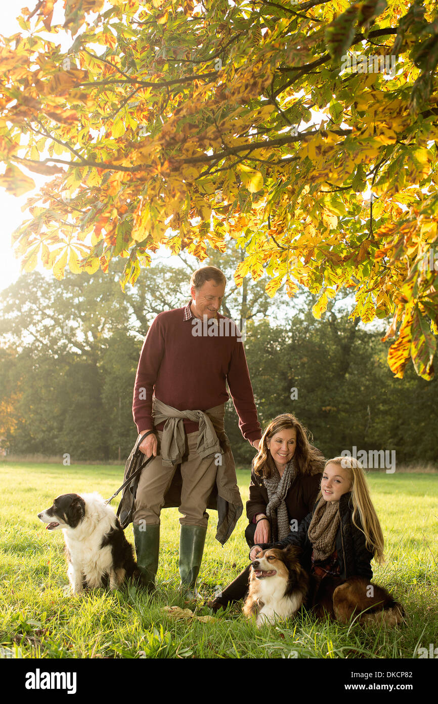 Portrait of grandparents and granddaughter with dogs, Norfolk, UK - Stock Image
