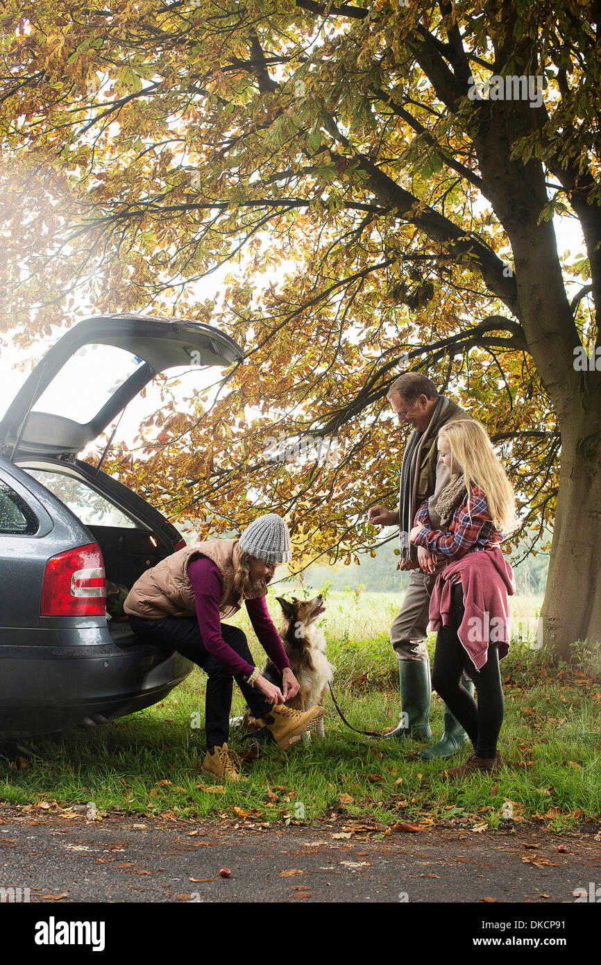 Family and dog preparing for walk from car boot, Norfolk, UK - Stock Image