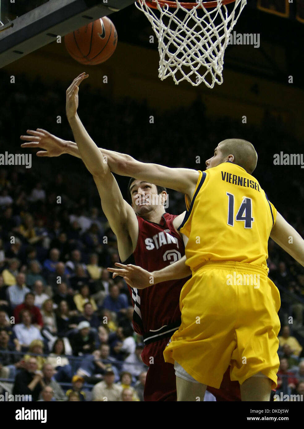 Feb 03, 2007 - Berkeley, CA, USA - California Golden Bear's ERIC VIERNEISEL, #14, fouls Stanford Cardinal's CARLTON WEATHERBY, #3, in the 2nd half of their game on Saturday, February 3, 2007 at Haas Pavilion in Berkeley, Calif. Stanford defeated Cal 90-71. - Stock Image