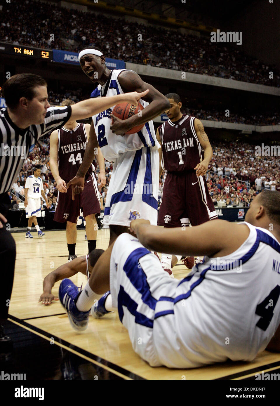 Mar 22, 2007 - San Antonio, TX, USA - To the dismay of Memphi ROBERT DOZIER (2) the referee indicts ball possession to the Aggies. Involved in the play are Memphis PIERRE NILES (4) and Aggies ANTANAS KAVALIAUSKAS (44) and Acie law IV (1) during second half action NCAA South Regional semifinal game at the Alamodome Thursday March 22, 2007.  (Credit Image: © William Luther/San Antoni - Stock Image