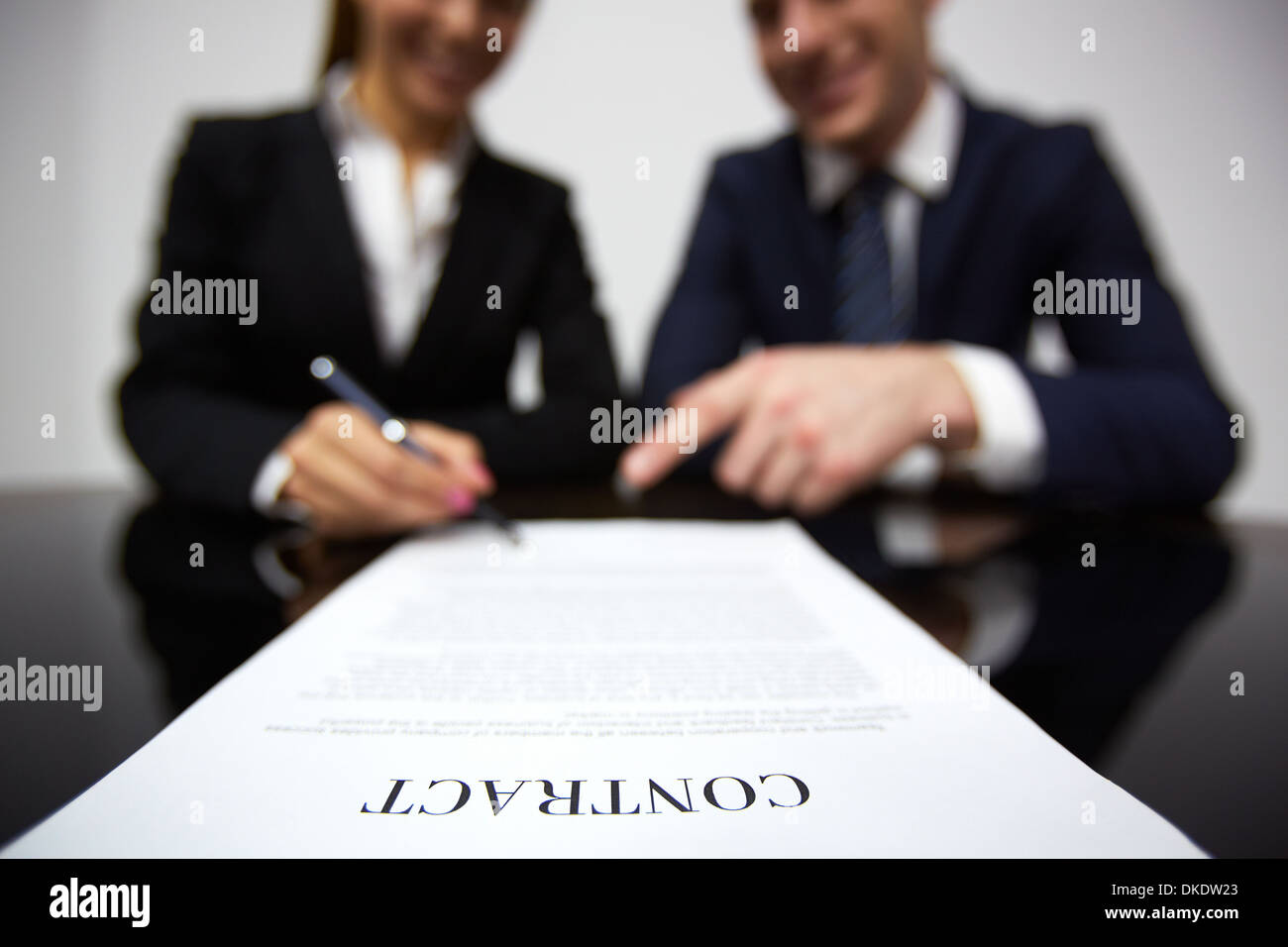 Image of human hands during signing contract - Stock Image